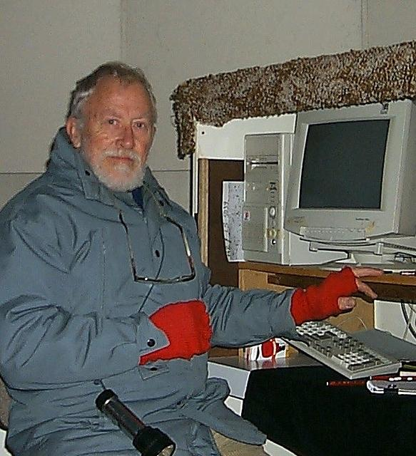 Bob Shobbrook dressed for a winters night at the control computer for the photometer on the ANU 24-inch telescope.
