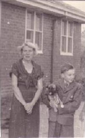 1958: Mrs. Bok at kids' birthday party with boy and his dog!