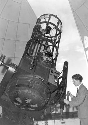 Walter Stibbs at telescope, 1950