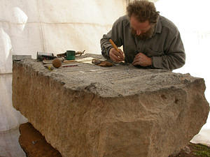 Leadbeater repairing the melted letters in the inscription