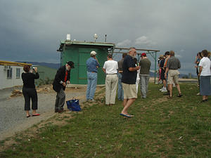Members gathering for the official opening; so are the storm clouds
