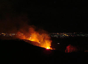 burn-off, eastern slope of Stromlo with lights of Canberra in distance, Oct 2004