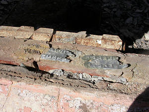 In several cases, lead flashing has melted and run onto brickwork, producing a negative moulding of the brick brand.