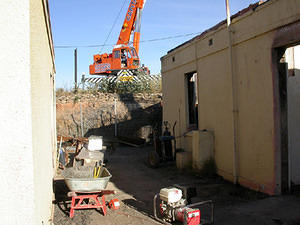 Crane, ready to lift boiler and bulky wreckage from the southern end of the courtyard.